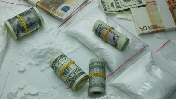 Thumbnail for Criminal Financial Profit Of The Drug Cartel From The Sale Of Cocaine And Narcotic Tablets