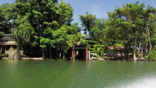 Surfing on the Rio Dulce, Guatemala