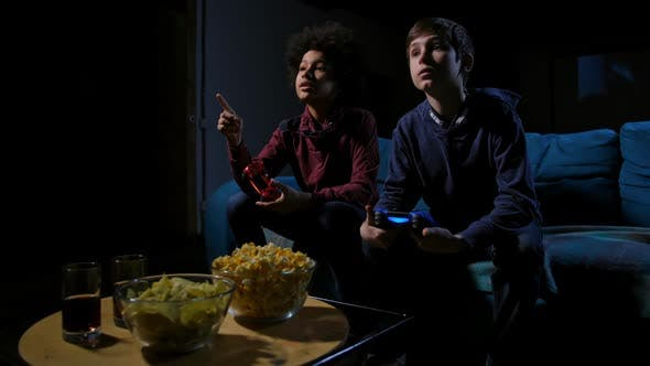 Thumbnail for Teen Boys Watching TV Screen, Choosing Video Game
