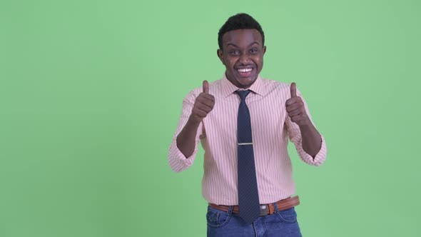 Thumbnail for Happy Young African Businessman Looking Excited While Showing Something