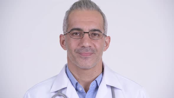 Thumbnail for Happy Persian Man Doctor Smiling Against White Background