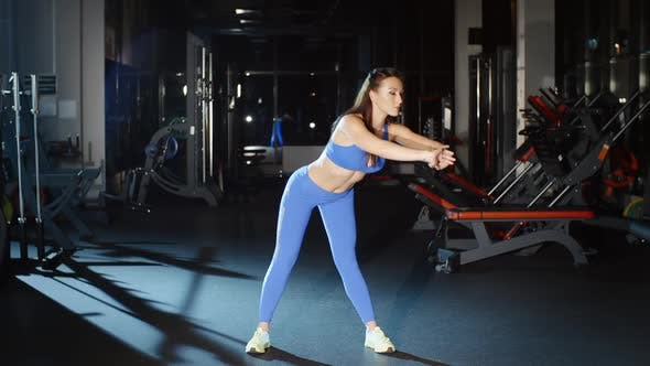 Thumbnail for Athletic Woman in Blue Fitness Leggings Leans Down Stretches Back