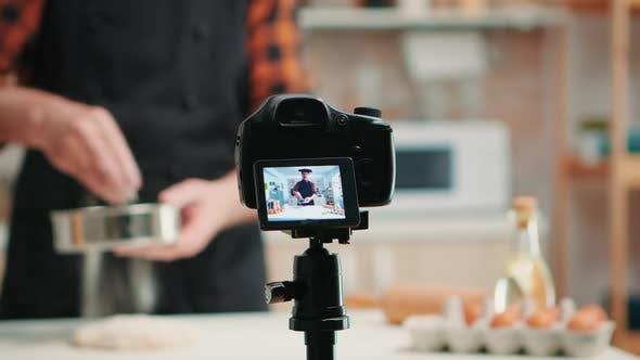 Video Camera Filming Man in Kitchen