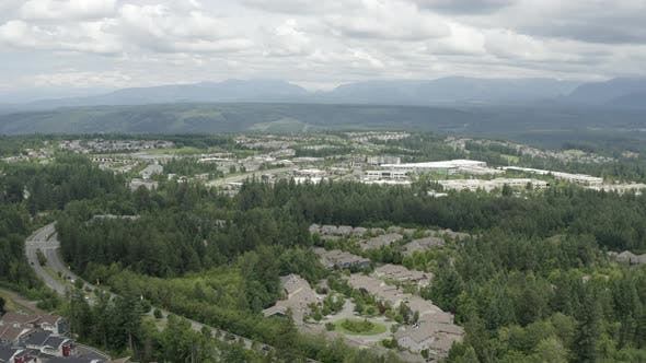Cover Image for Snoqualmie Ridge Washington Housing Community Aerial Overview Of Neighborhood Homes Roads