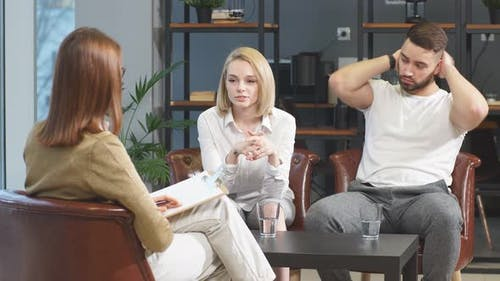 Upset and Aggrieved Married Couple Visit Professional Psychologist