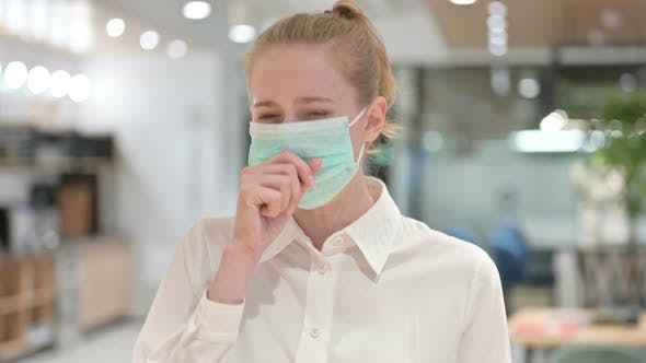 Portrait of Sick Young Businesswoman with Face Mask Coughing