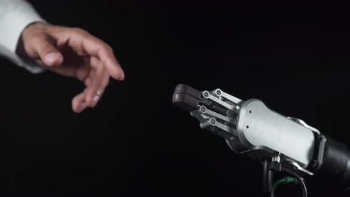 Futuristic Robot Arm Touches Human Hand, Process of Communication and Interaction