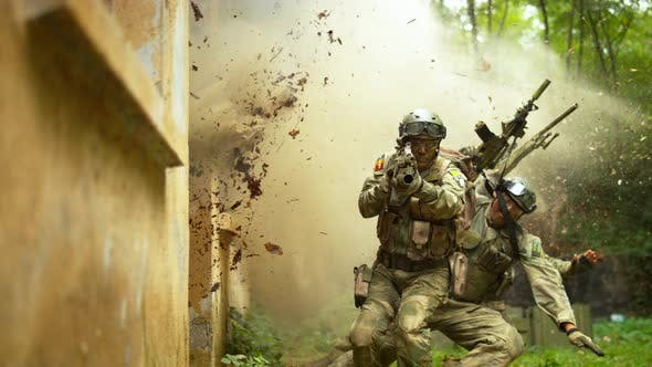 Thumbnail for Explosions near soldiers, slow motion