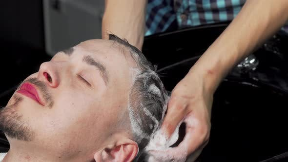 Thumbnail for Man Getting His Hair Washed By Professional Hairstylist