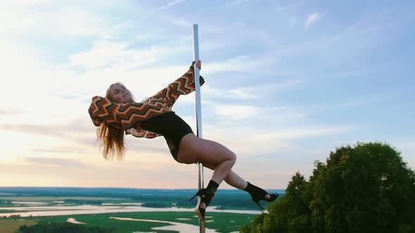 Thumbnail for Pole Dance on Nature - Sexy Woman in Swimsuit and Colorful Knitted Crop Top Dancing on the Top of