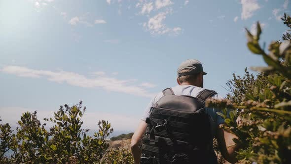 Thumbnail for Middle Aged Tourist Man with Photographer Backpack Hiking