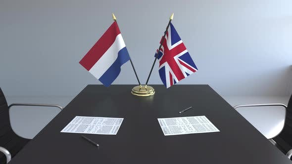 Flags of the Netherlands and the United Kingdom on the Table