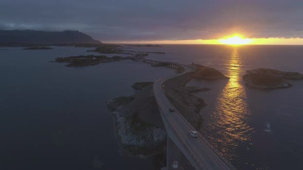 Thumbnail for Atlantic Ocean Road in Norway at Sunset. Cars Are Passing on Storseisundet Bridge. Aerial View