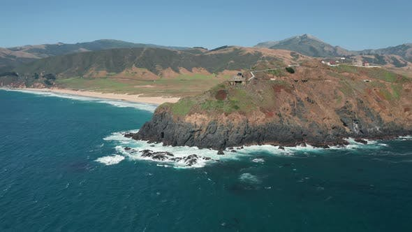 Thumbnail for Bird-eyes View on Incredible Shore with Lighthouse on High Rocky Island.
