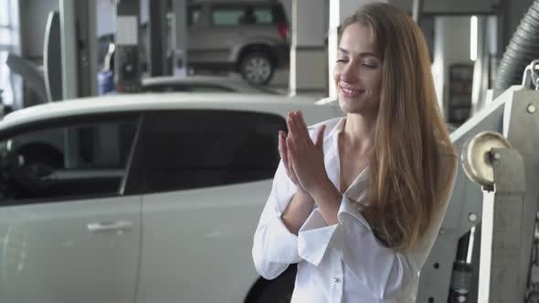 Thumbnail for Young Happy Woman in Car Service Throwing Up Her Car Keys and Smiling and Cheering on the Background