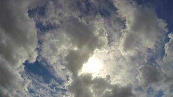 Thumbnail for Large Fluffy Clouds Hiding Summer Sun in the Sky, Beautiful Cloudscape Timelapse