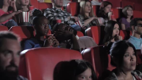 African American Man Sleeping During Horror Movie