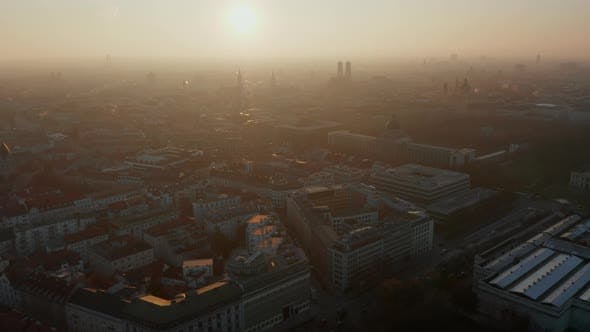 Thumbnail for Beautiful Winter Haze Fog in the Air Above Cityscape of Munich Germany Scenic Aerial View with