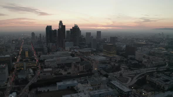 Thumbnail for AERIAL: Breathtaking View of Skyscrapers in Downtown Los Angeles, California at Beautiful Sunset