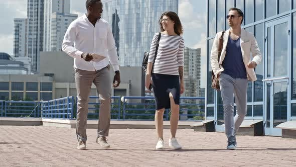 Thumbnail for Coworkers Walking Outdoors and Discussing Business