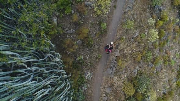 Thumbnail for Traveler Walking on the Way in Desert or Mountains