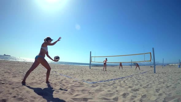 Thumbnail for POV of women players playing beach volleyball and serving.