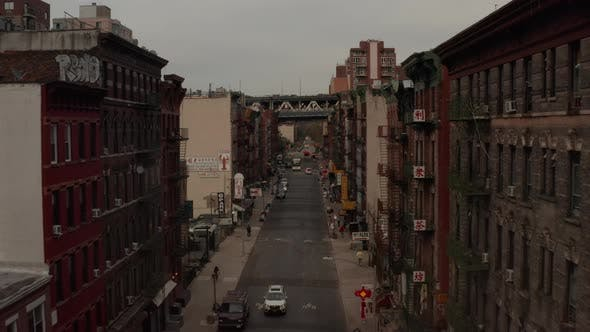 Thumbnail for Low Flight Through Chinatown, New York City Street with Chinese Asian Letters Towards Bridge