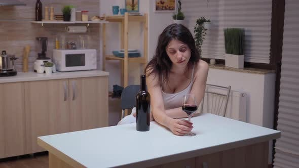 Thumbnail for Depressed Woman Drinking Alone