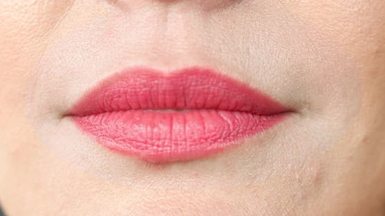 Thumbnail for Extreme Close-up Female Mouth with Pink Lipstick Smiling Showing White Healthy Beautiful Teeth