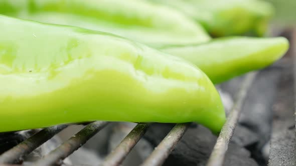 Thumbnail for Green organic peppers grilled on bbq close-up 4K 3840X2160 UltraHD footage - Capiscum annuum vegetab