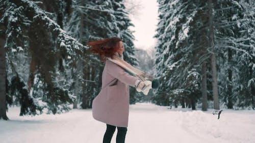 Joyful Female Whirl in Winter Forest