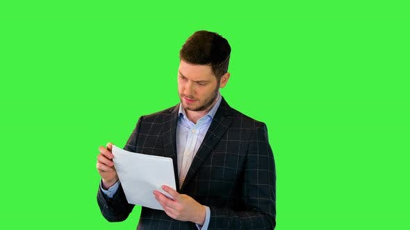 Concentrated on Work Millennial Businessman Read Documents Attentively Business Man Check Contract