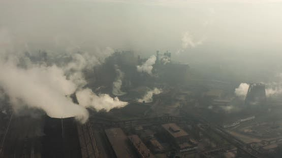 Top View of the Metallurgical Plant. Smoke Coming Out of Factory Pipes. Ecology