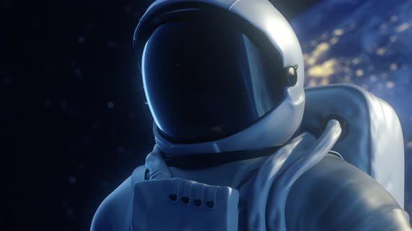 Alone astronaut looks at the planet earth in orbit in outer space