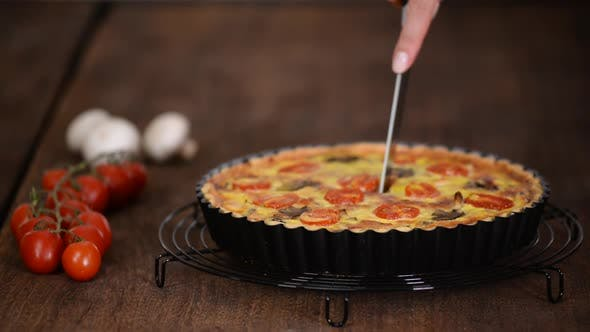 Thumbnail for Cutting Homemade Quiche Lorraine with Chicken, Mushrooms and Cheese, French Cuisine