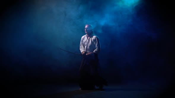 Thumbnail for Aikido Master Technique Demonstration with Japanese Sword Katana on Blue Smoke Background.