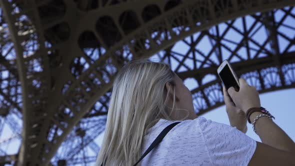 Thumbnail for Happy Woman Taking Panoramic Picture Under Eiffel Tower