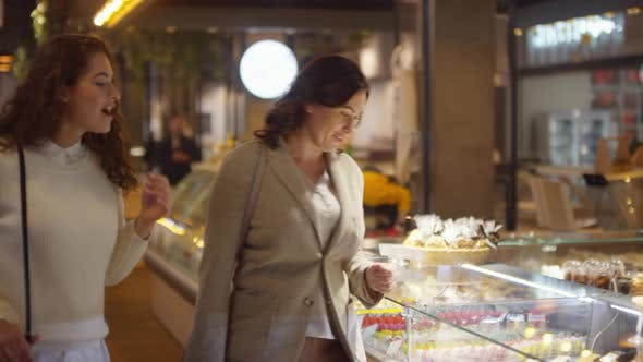 Thumbnail for Two Female Customers Speaking with Saleswoman at Cake Shop