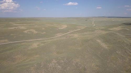 Long Winding Dirt Country Road in Wyoming Nebraska Rangeland in Summer
