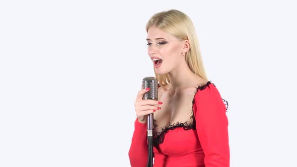 Thumbnail for Girl Dances and Sings in a Retro Microphone. White Background