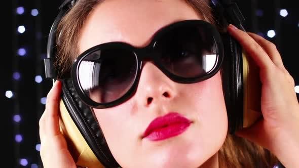 Girl Wearing Sunglasses and Headphones