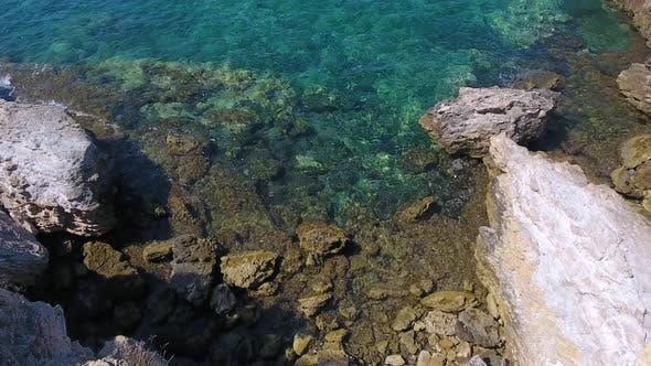 Rocky and Stony Seashore in Untouched Sea