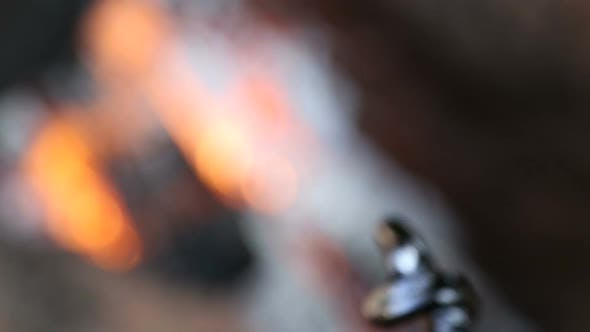 Thumbnail for Metall mater melting by fire and shaping around a stick.