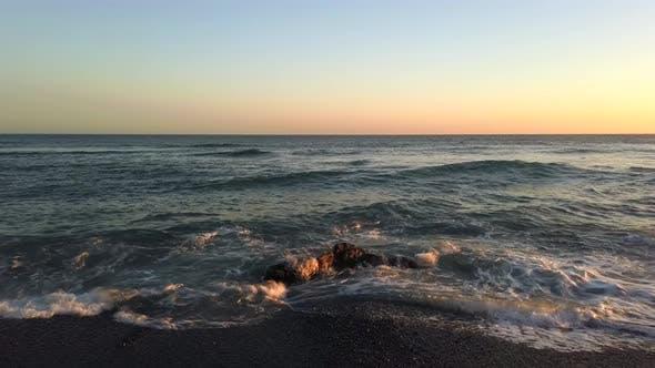 Thumbnail for Ocean Waves On Sunset