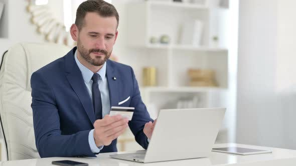 Thumbnail for Businessman Making Successful Online Payment at Work