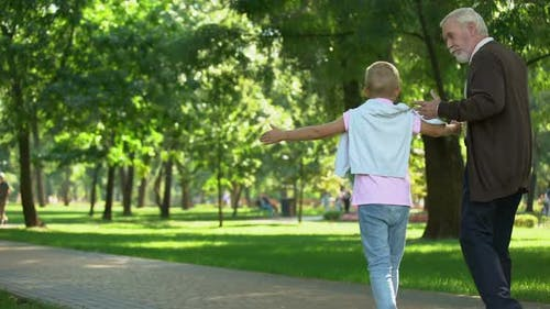 Granddad Walking With Grandson, Shares Experience, Education of New Generation