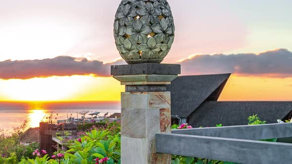 Thumbnail for The Sculpture Sand Stone of Lantern Floral Pattern on Sunrise and Sea Background in Amed Beach, Bali