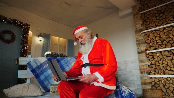 Thumbnail for Jocund Father Christmas Talking with Video By Laptop.