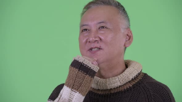 Thumbnail for Face of Happy Mature Japanese Man Thinking and Looking Up Ready for Winter