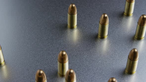 Cinematic rotating shot of bullets on a metallic surface - BULLETS 049
